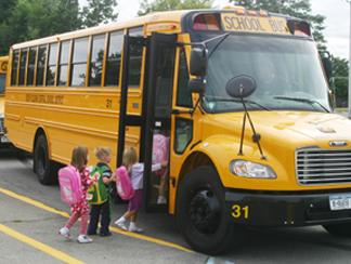 children boarding a yellow school bus