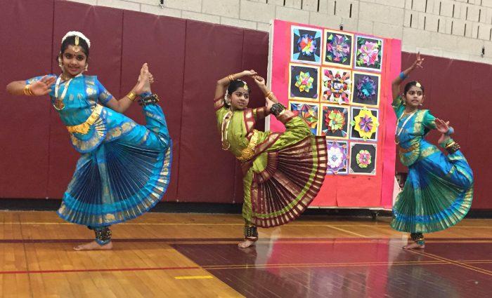 three Indian dancers perform