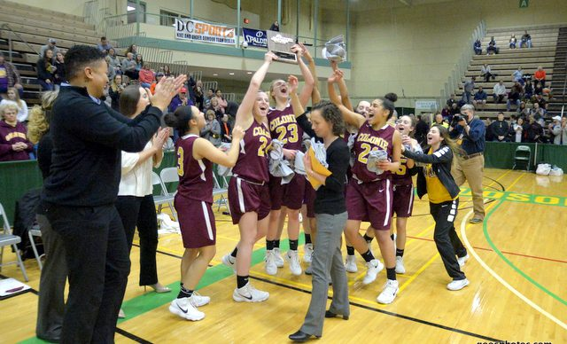 girls basketball players celebrate sectional title win