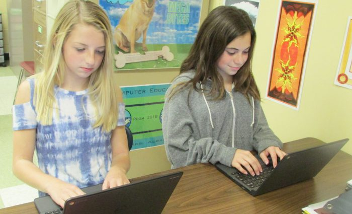 two female students working