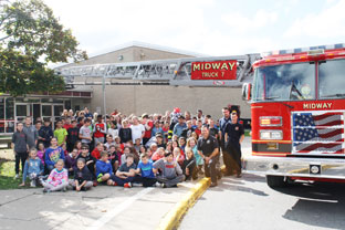 students with fire truck