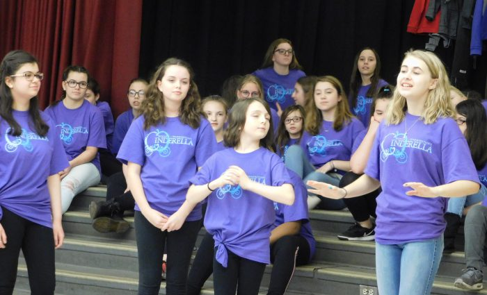 middle school actors sing together