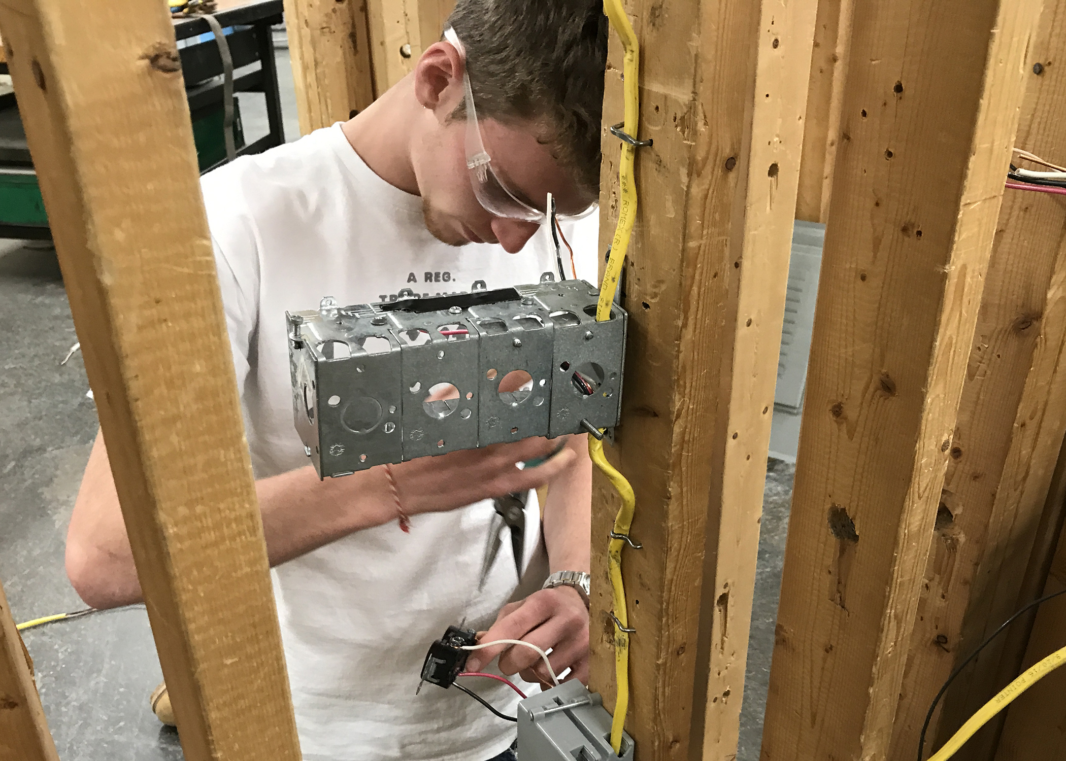 Students works on an electrical box