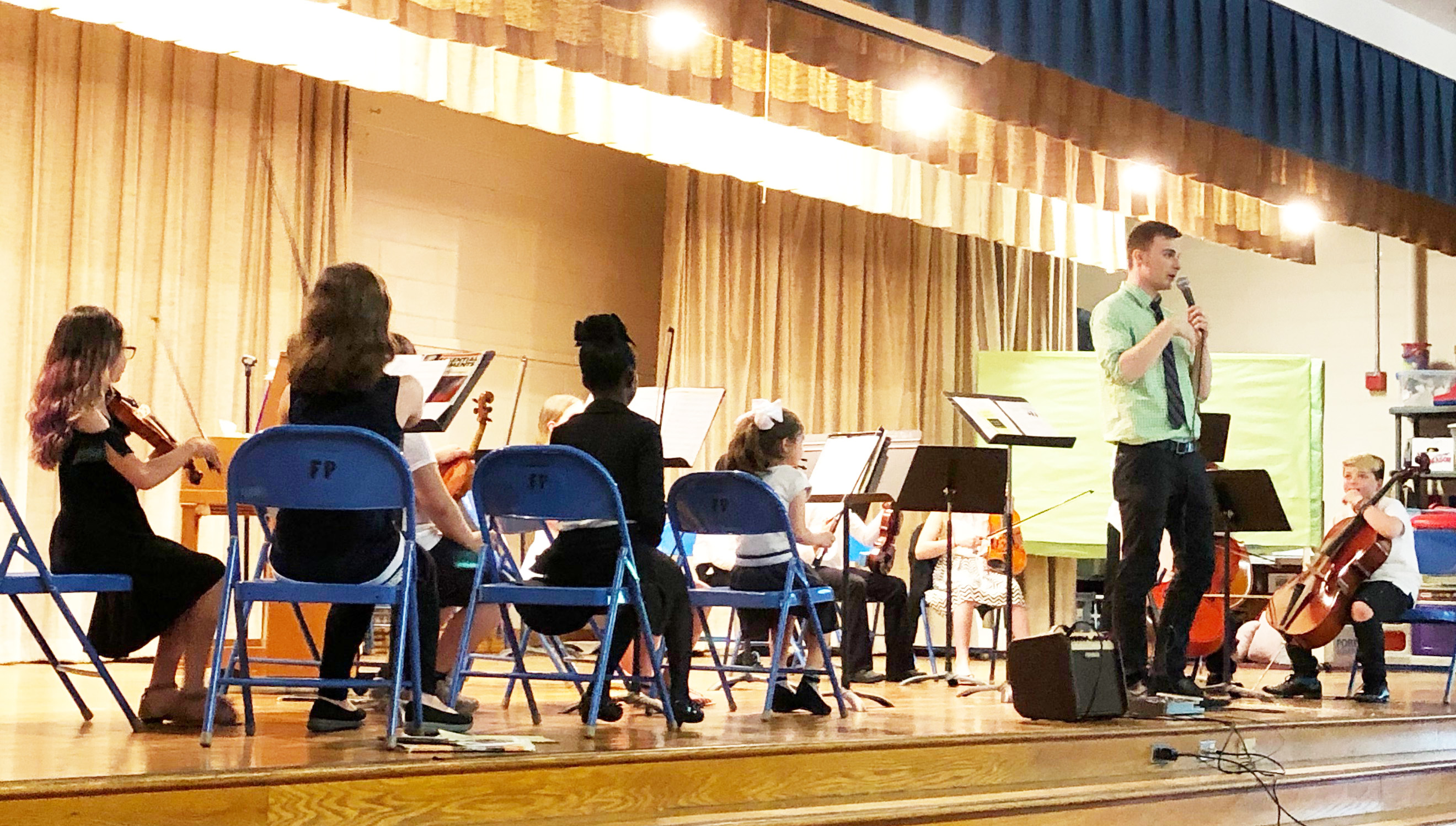 4th grade musicians perform on stage