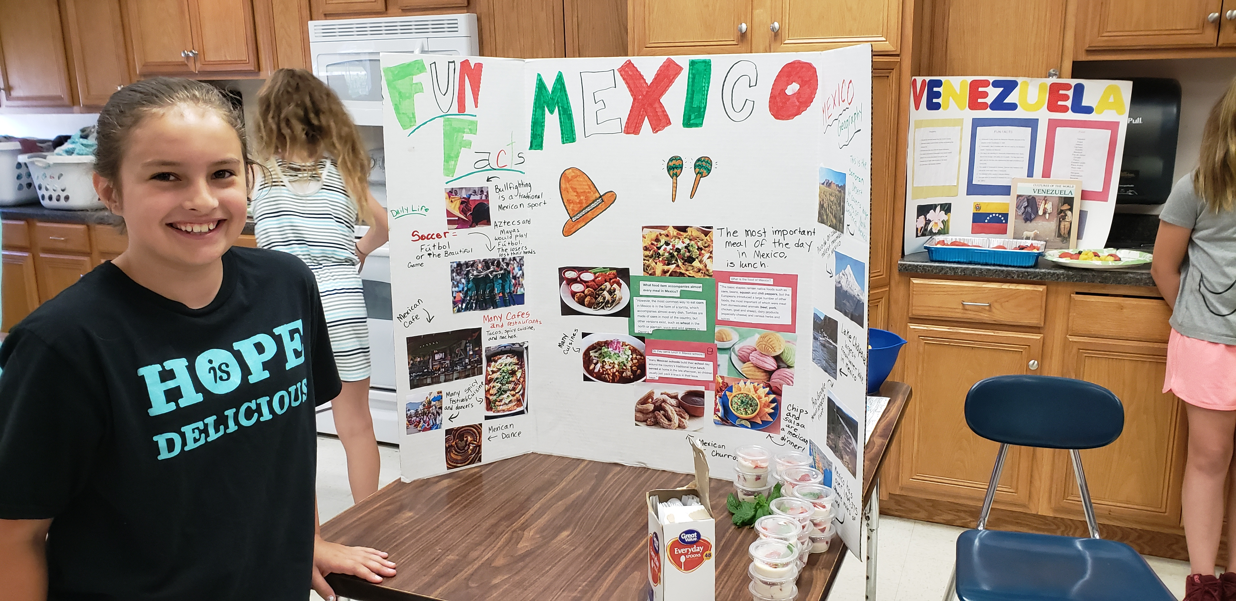 a girl shows her table display of Mexico