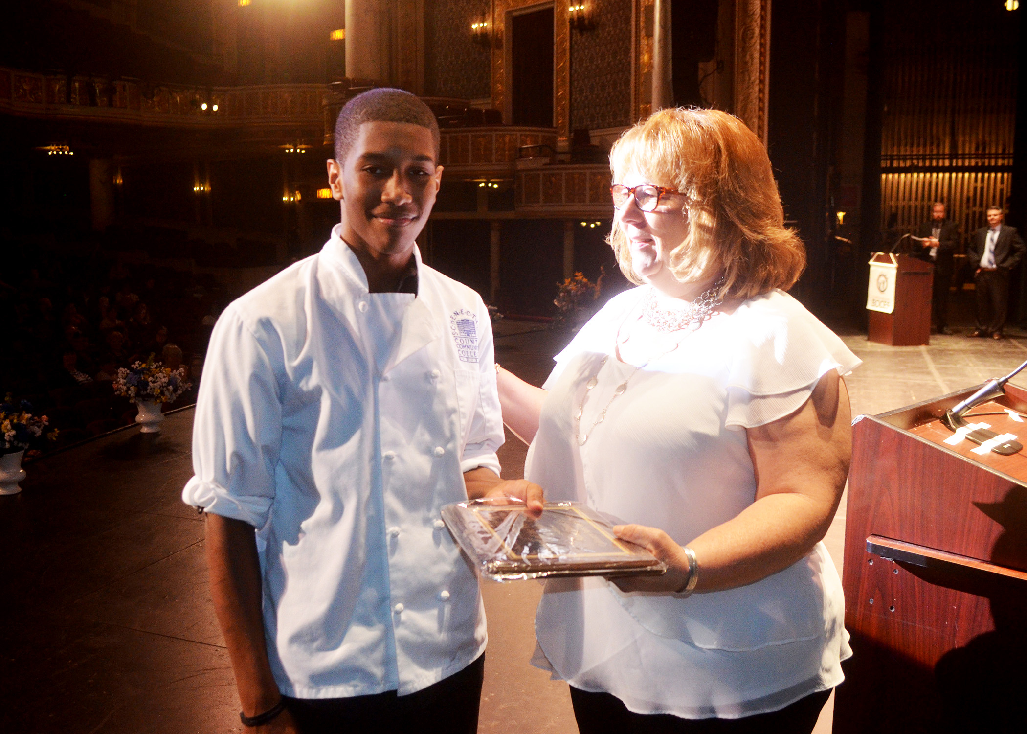 culinary student receives an award from his teacher