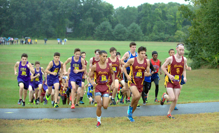 group of high school cross country runners on a course