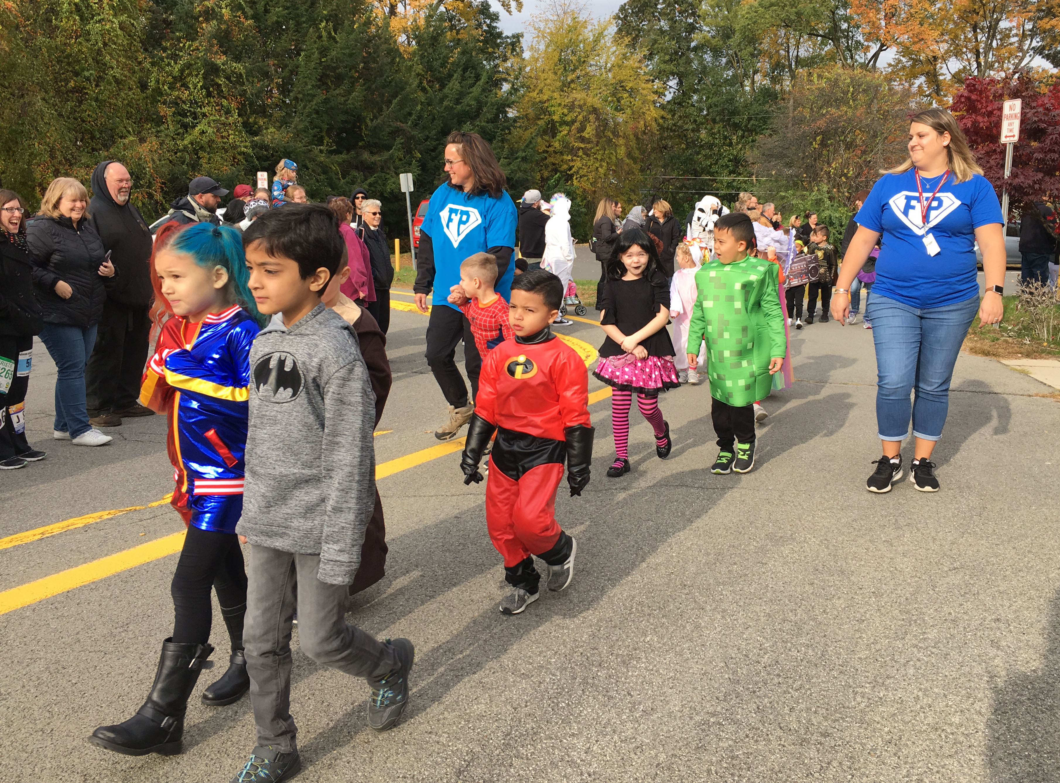 children march in a halloween parade in costume