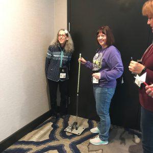 teachers work with a long handled rocket