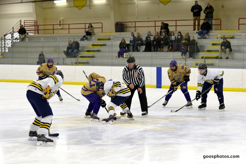 hockey teams face off at center ice