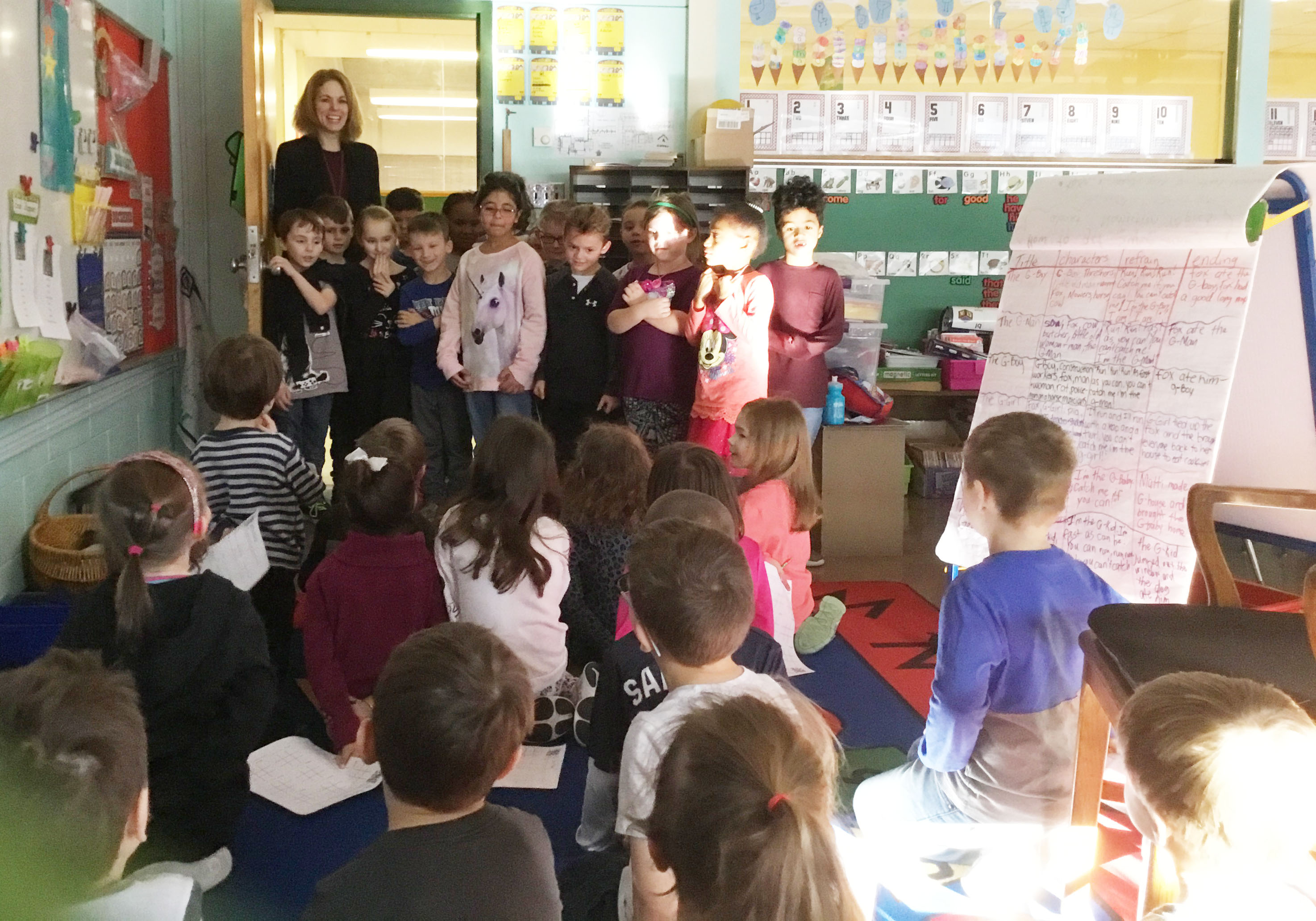 kindergartners sing to a group of students