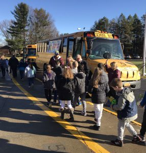 students march to the school bus