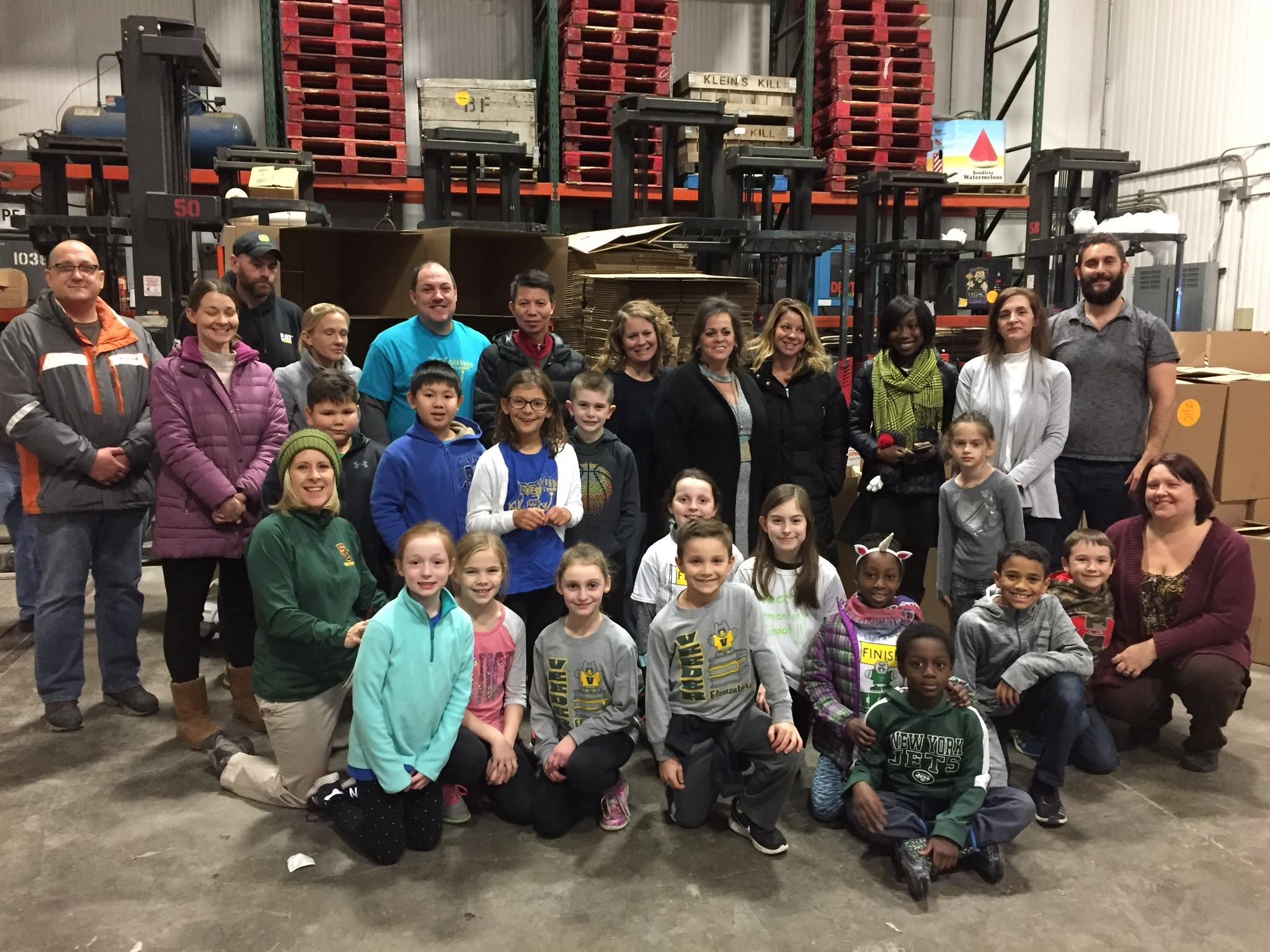 large group of students gather at the food bank