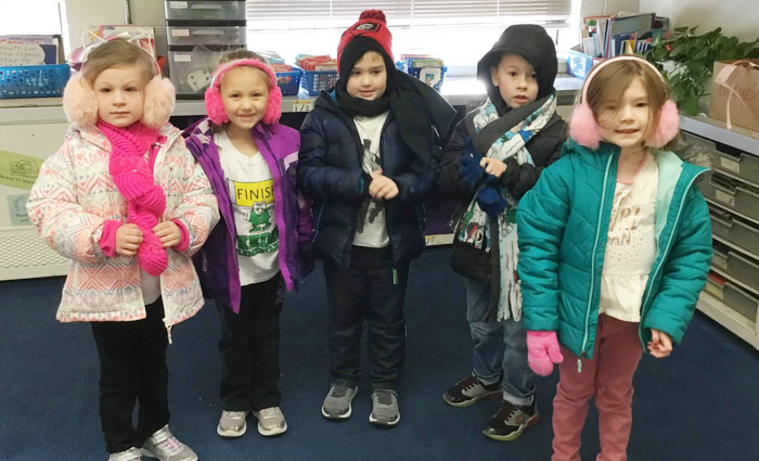 boys and girls dressed in their winter coats and hats