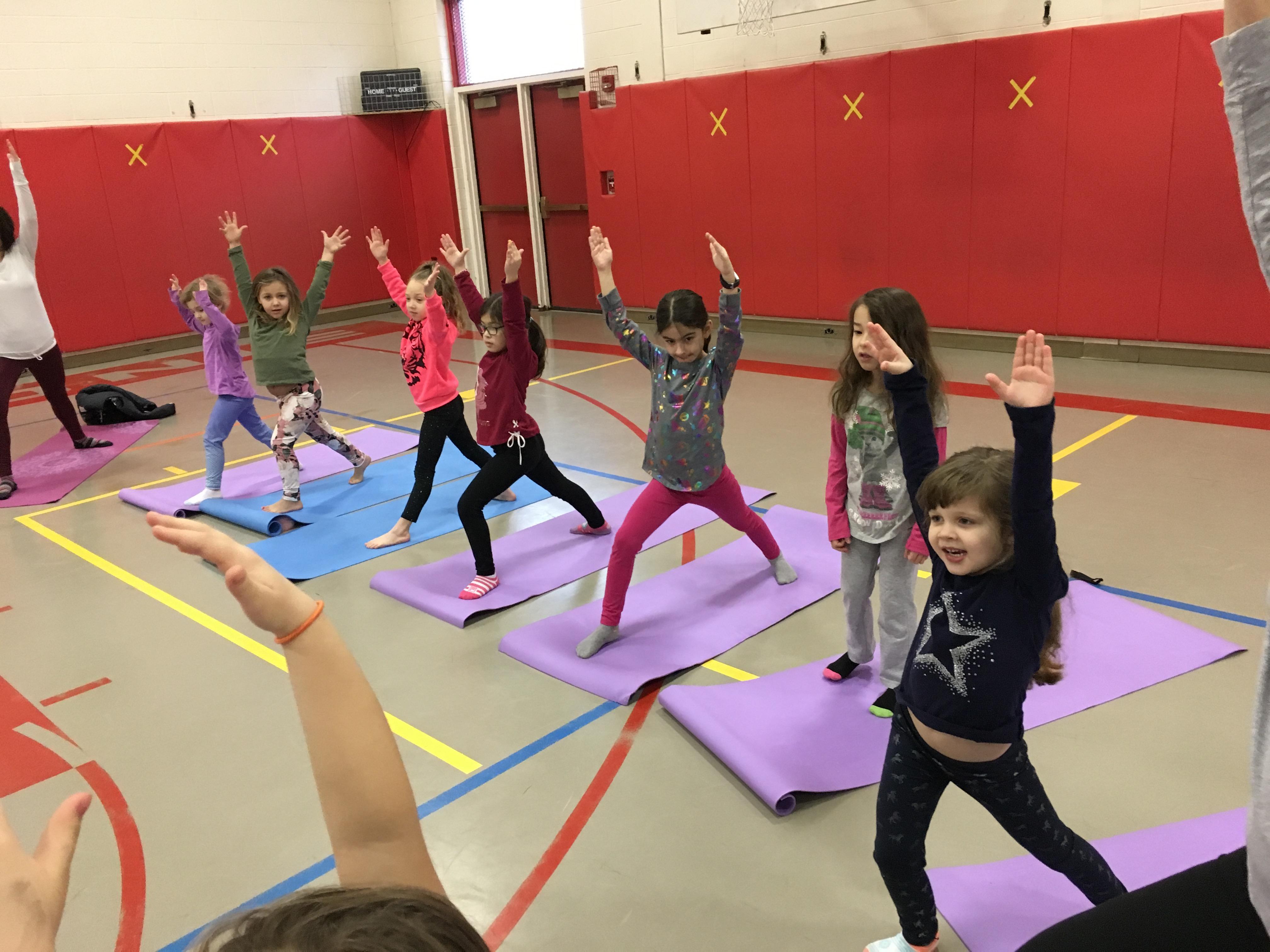 children participate in yoga