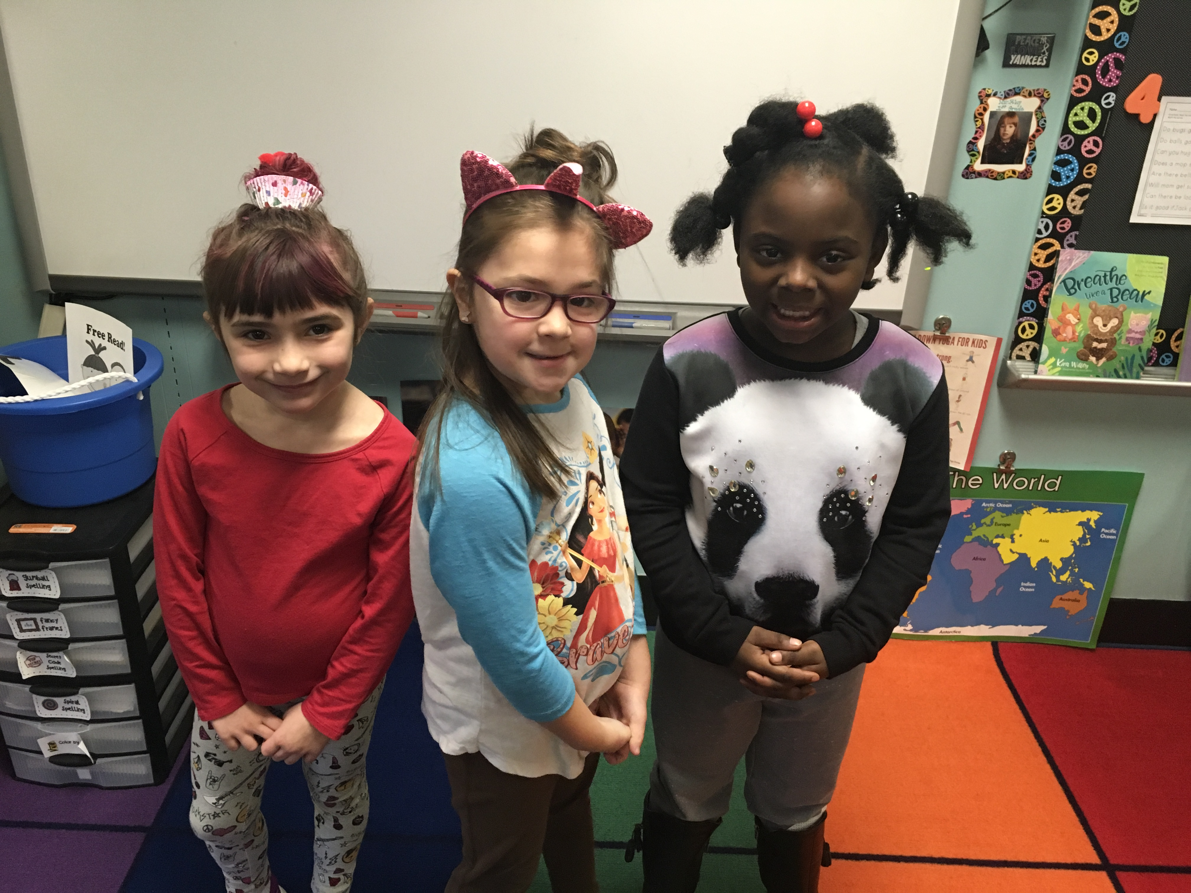 three students show off their wacky hair
