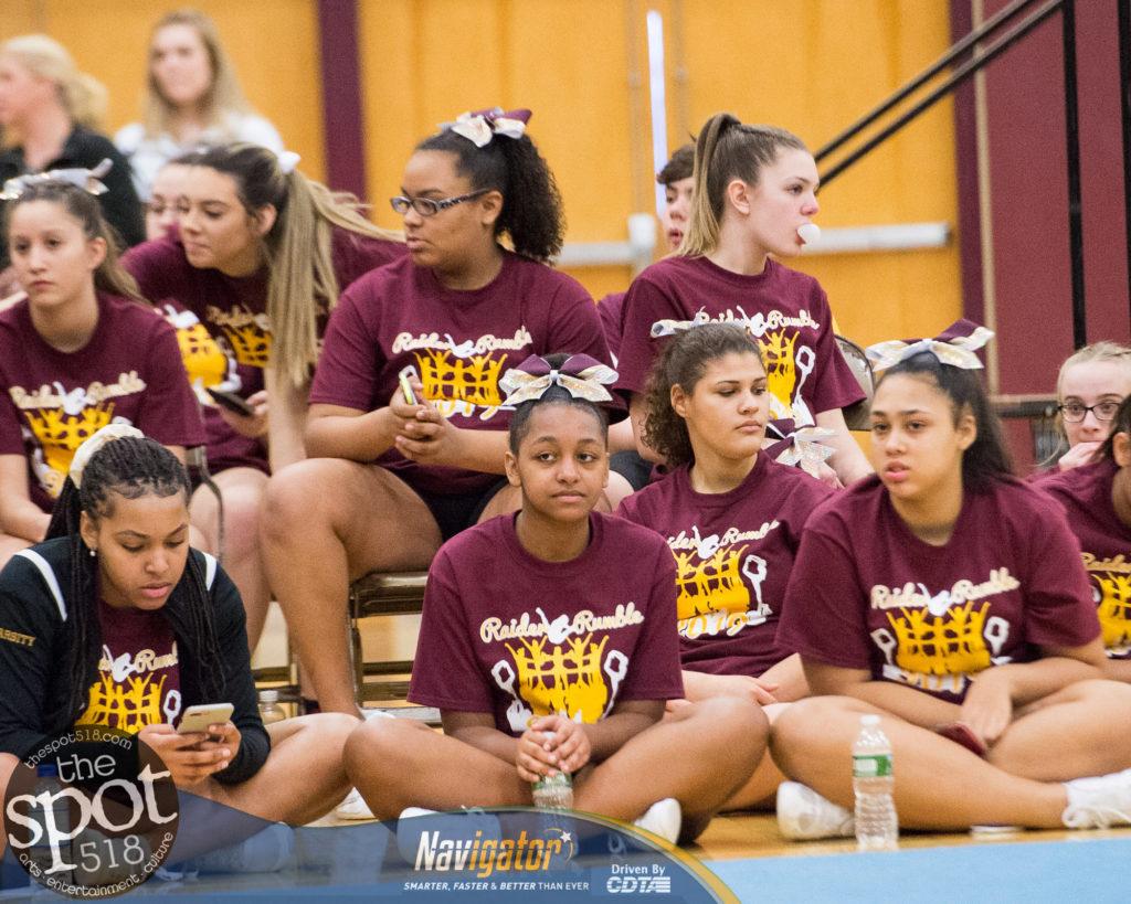 cheerleaders sitting on the floor