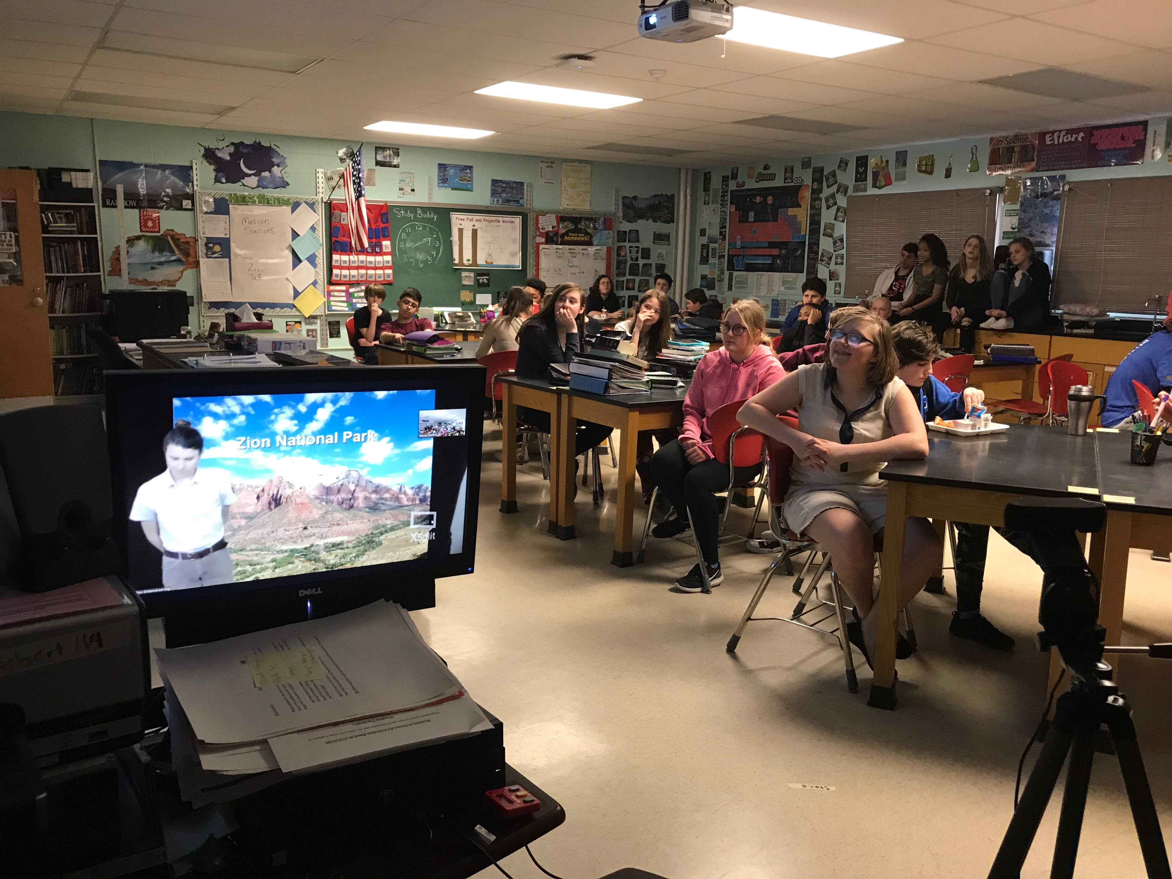 students participate in video conference in a classroom