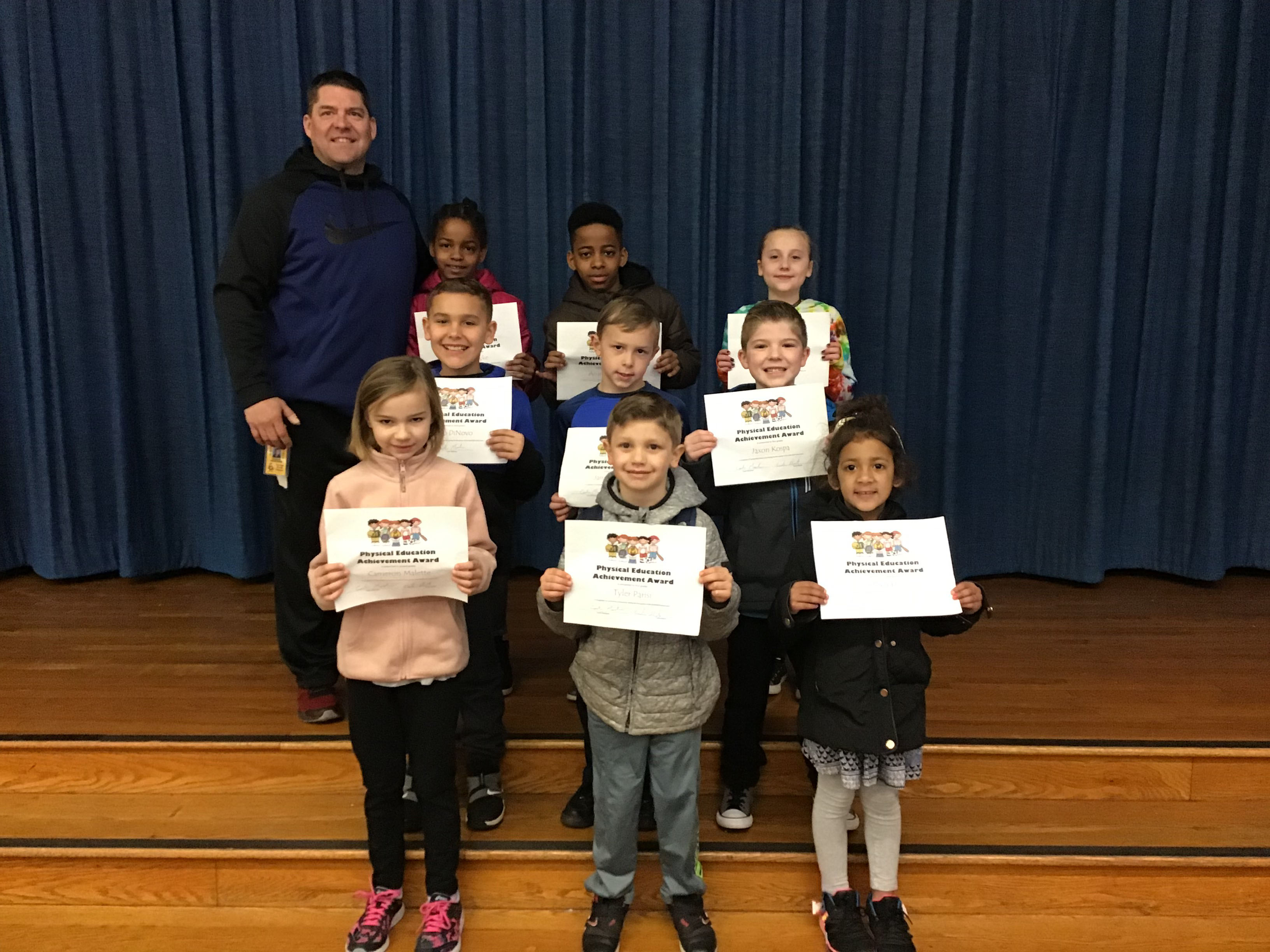 group of students hold their award certificates