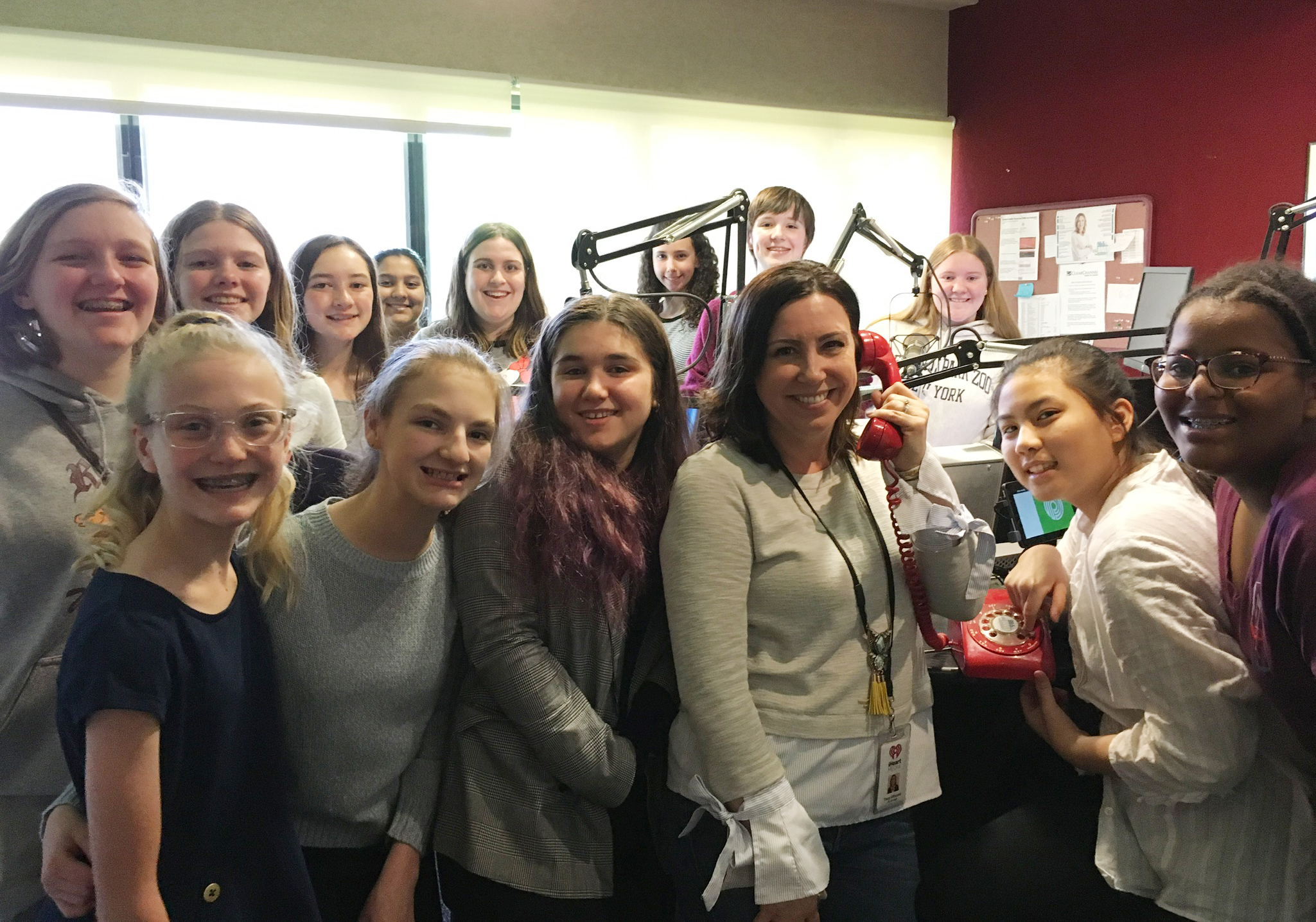 group of 8th grade students in the radio station studio