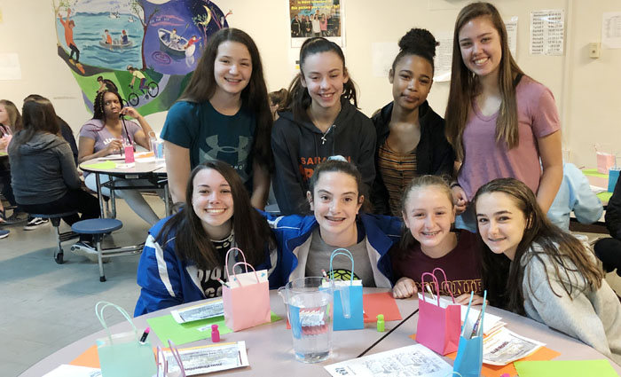 group of smiling girls at a table