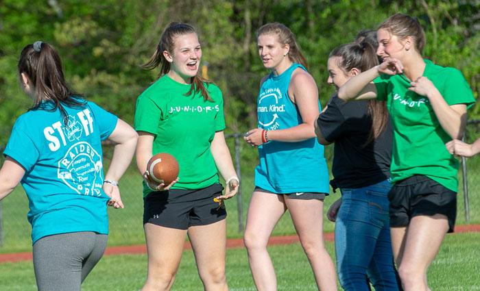 girl play football together