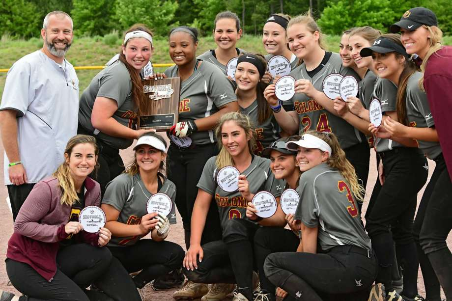 group of softball players with their trophy