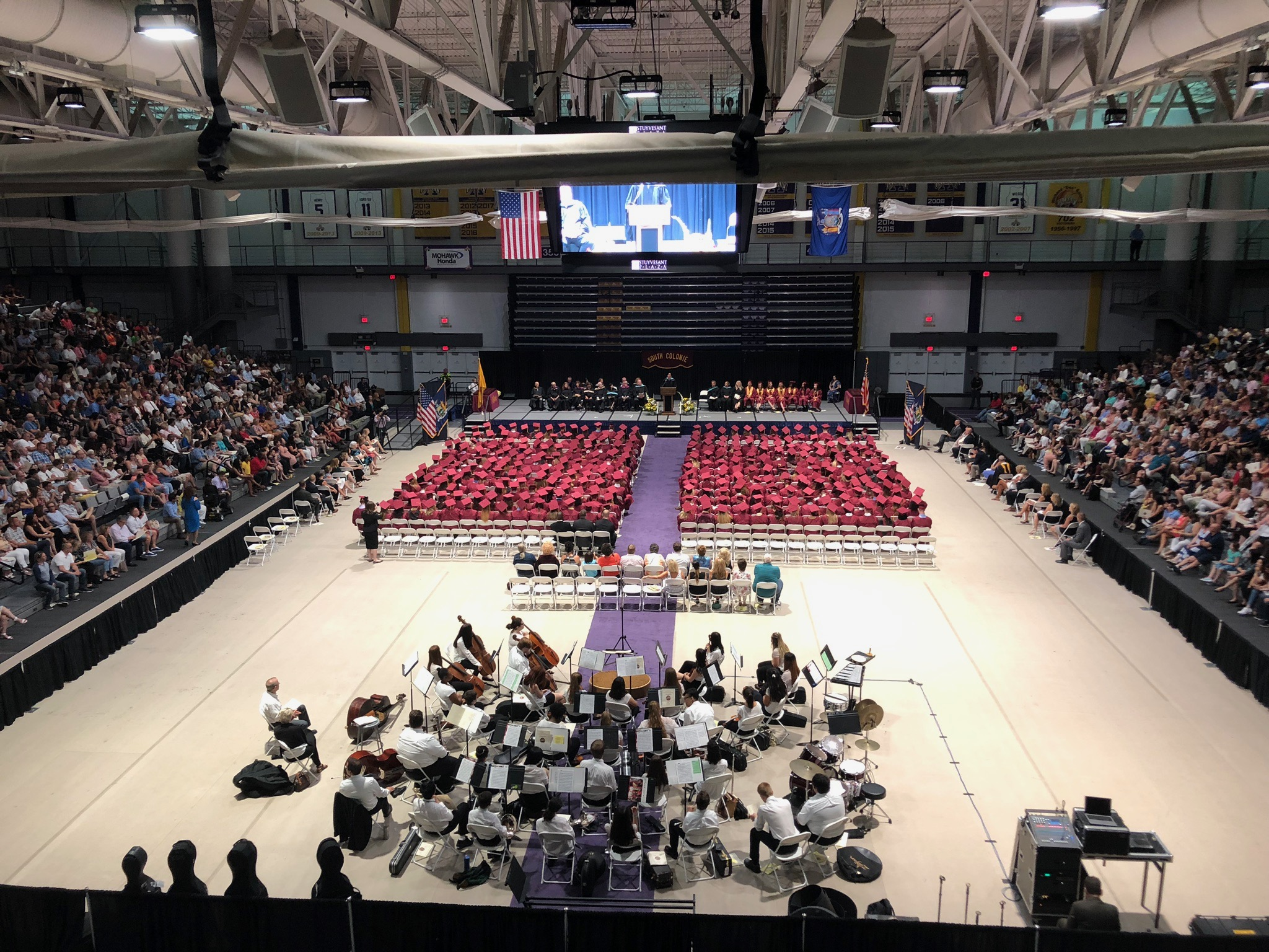 long view of the graduation class  and band