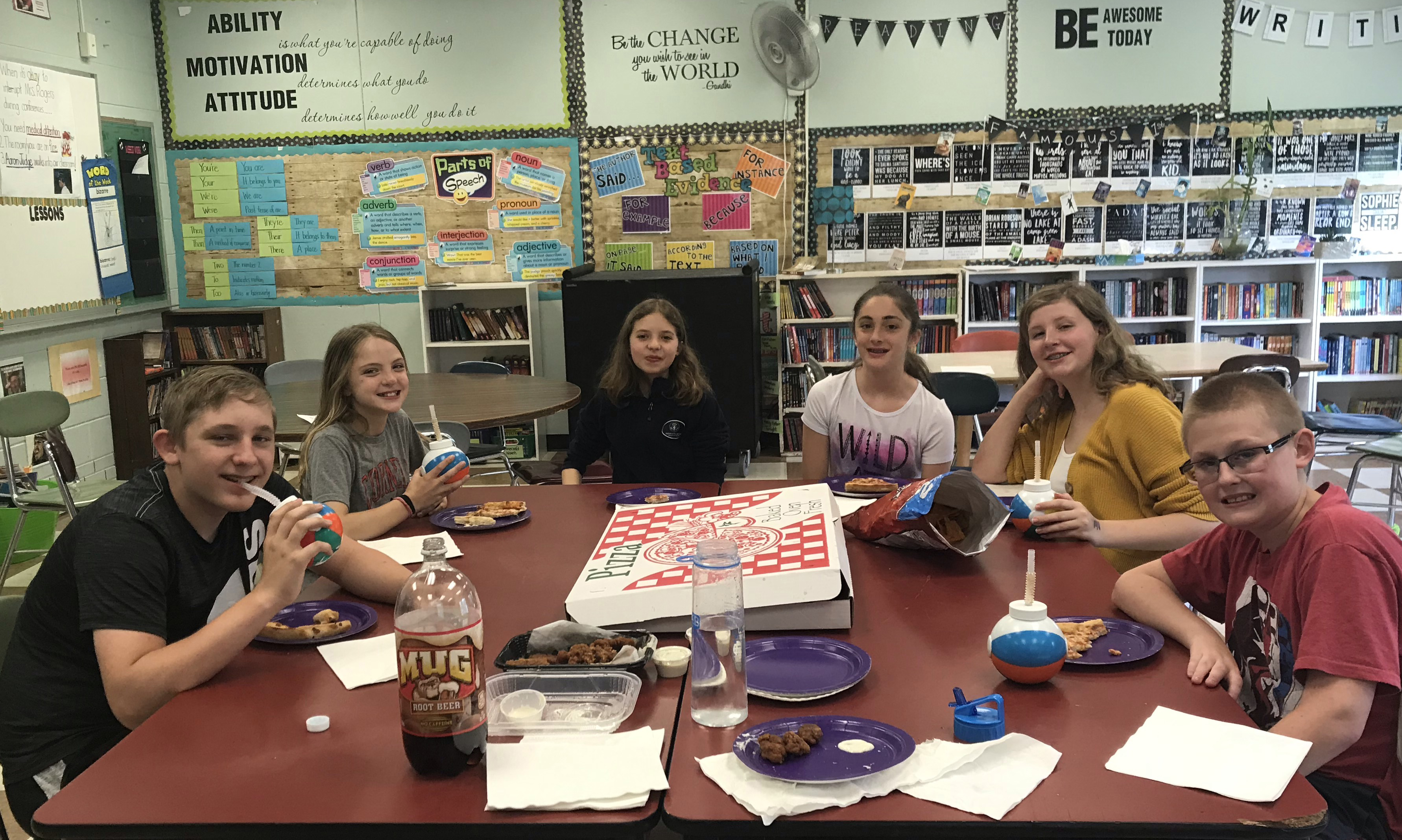 6 students enjoy a pizza party