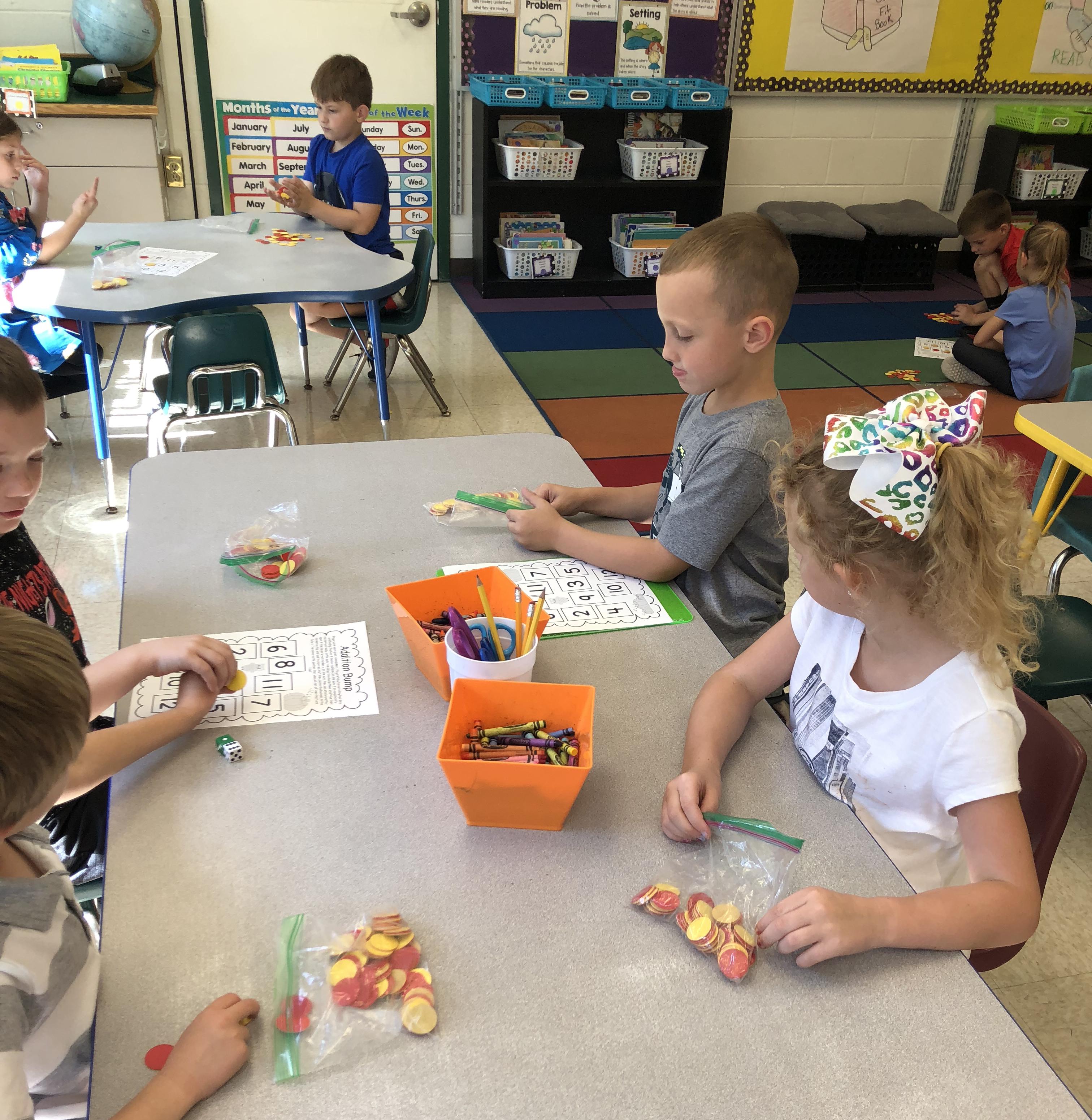 children work on math together