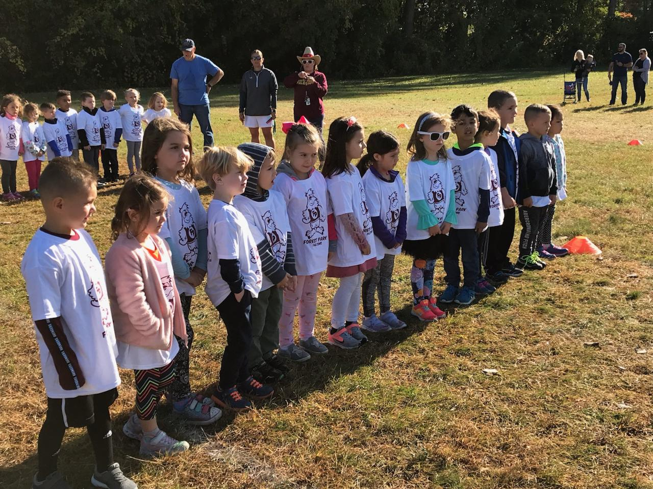 students line up in their T shirt for start of fun run