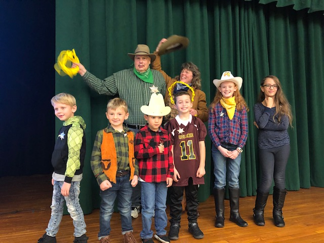 group of students and teacher dressed in cowboy gear