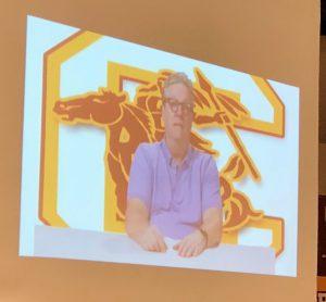 man on a TV screen