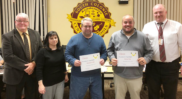 bus personnel holds award certificates with 2 board members and superintendent of schools