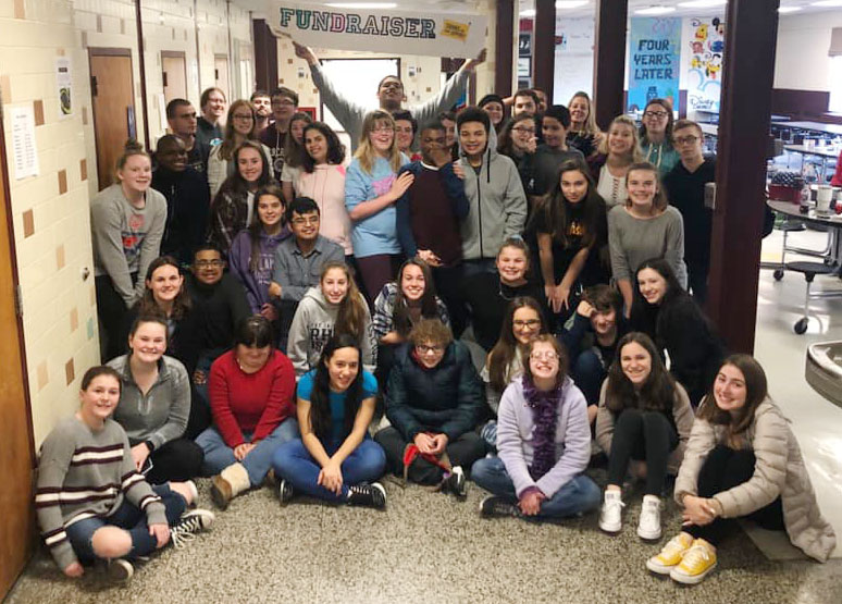 large group of high school students gather for photo