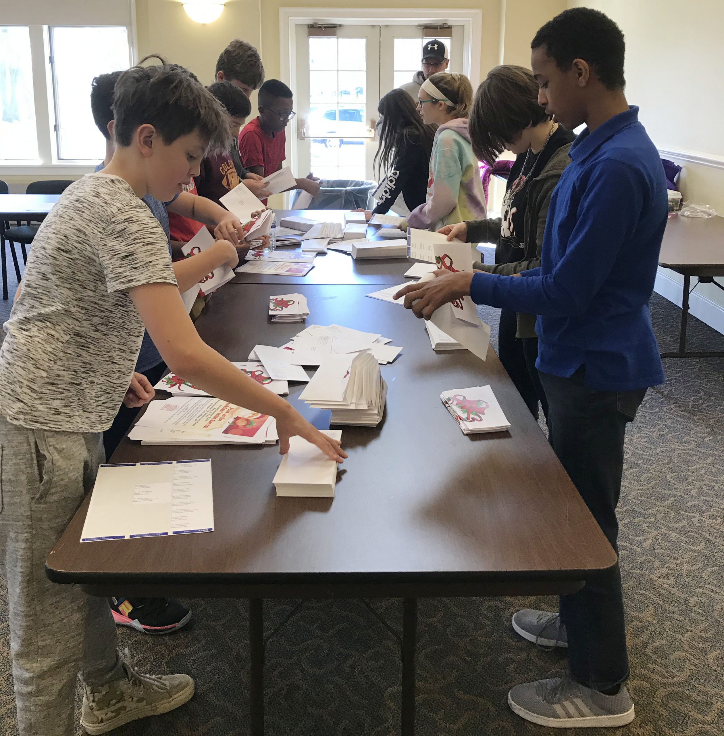 students sort mail at a table
