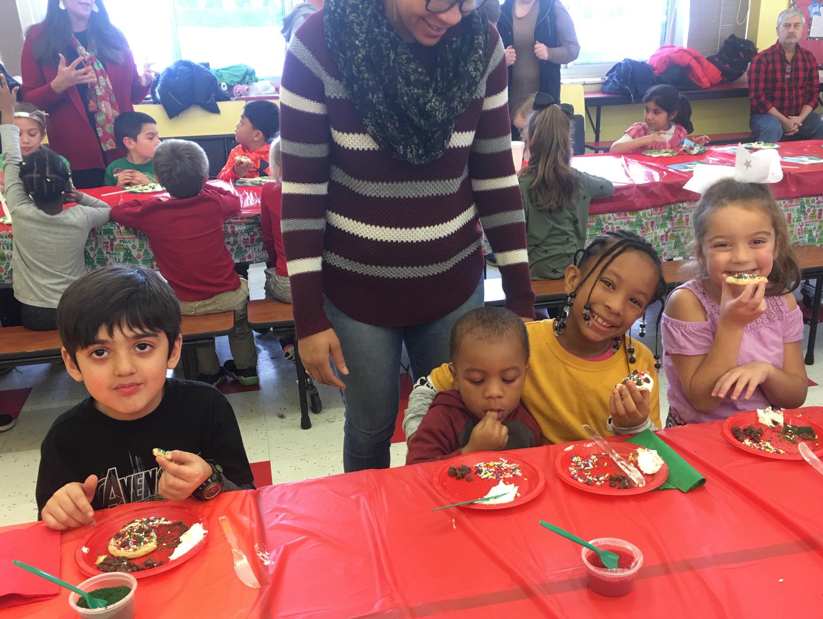 children enjoy eating cookies together