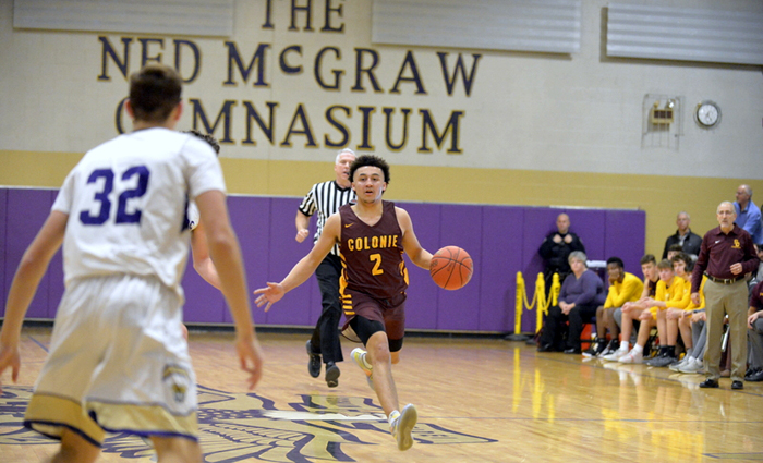 colonie player dribbles ball up the court with a defender in front of him