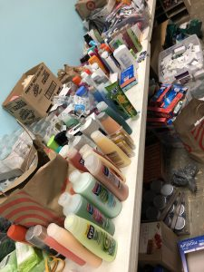 a collection of hygiene products lined up on a table